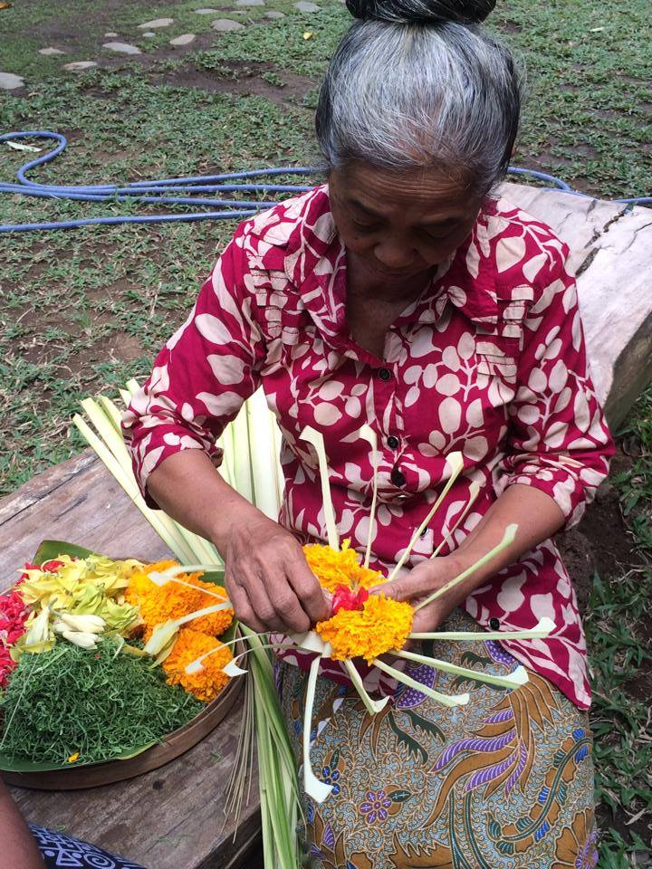 Making an offering and the basket that holds it