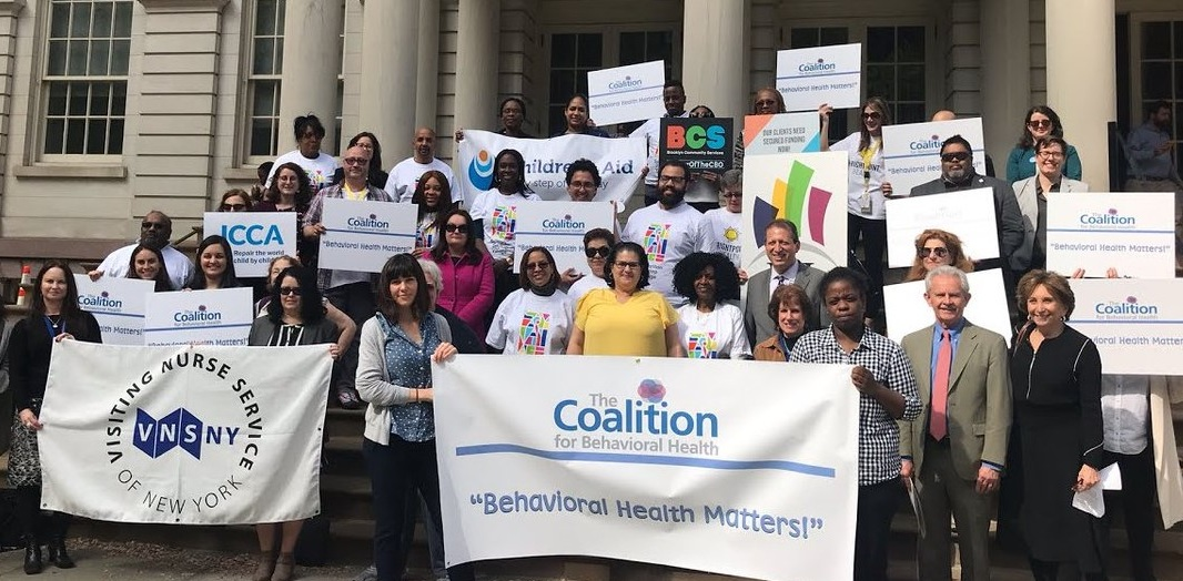 CEO Amy Dorin & Board Vice President David Woodlock (ICL) and member agencies join Council Members Diana Ayala and Brad Lander on the steps of City Hall for a rally in support of increased funding for behavioral health programs.