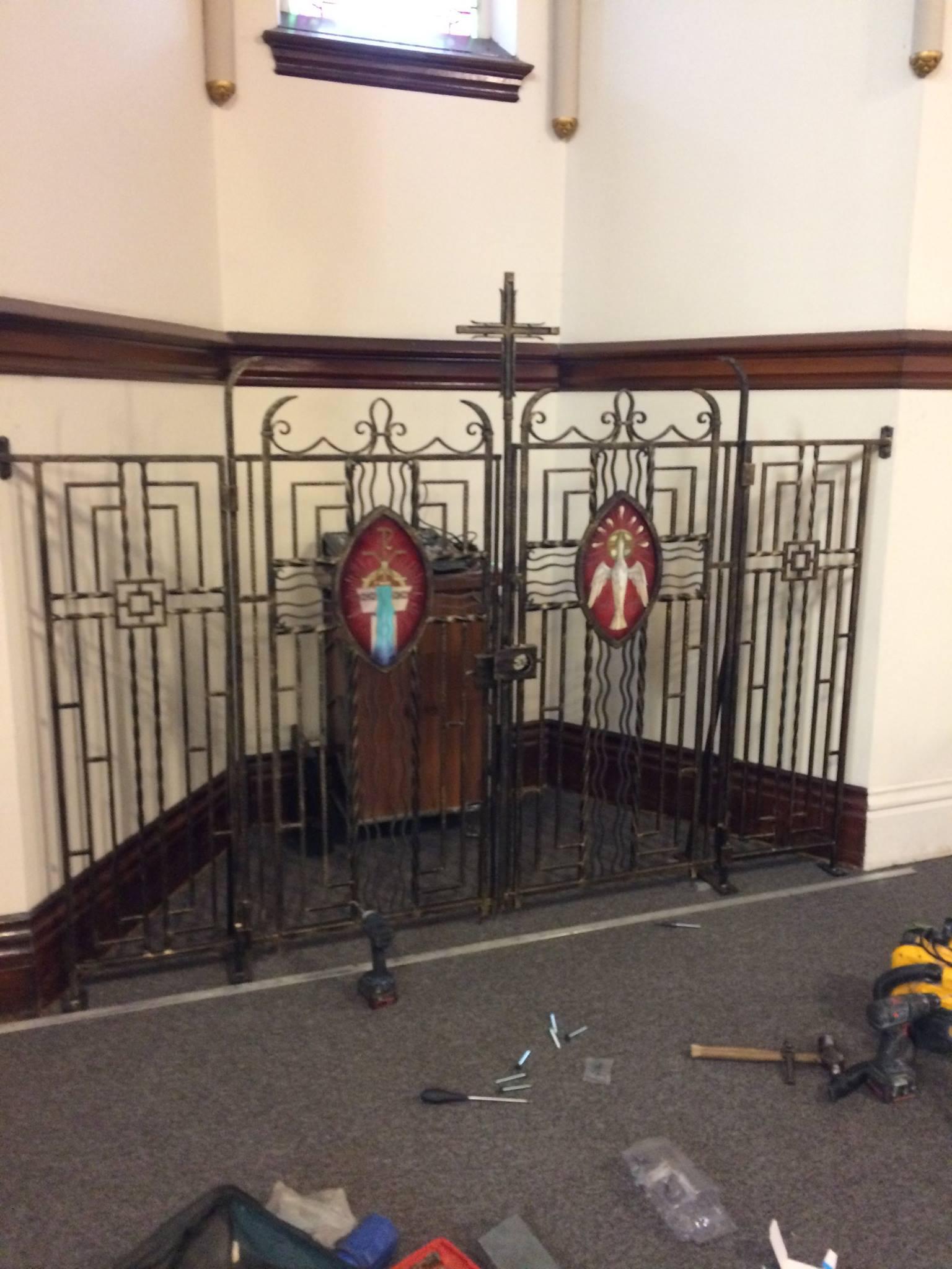 Original baptismal gates of the parish are repurposed for AV/Choir area, 2018