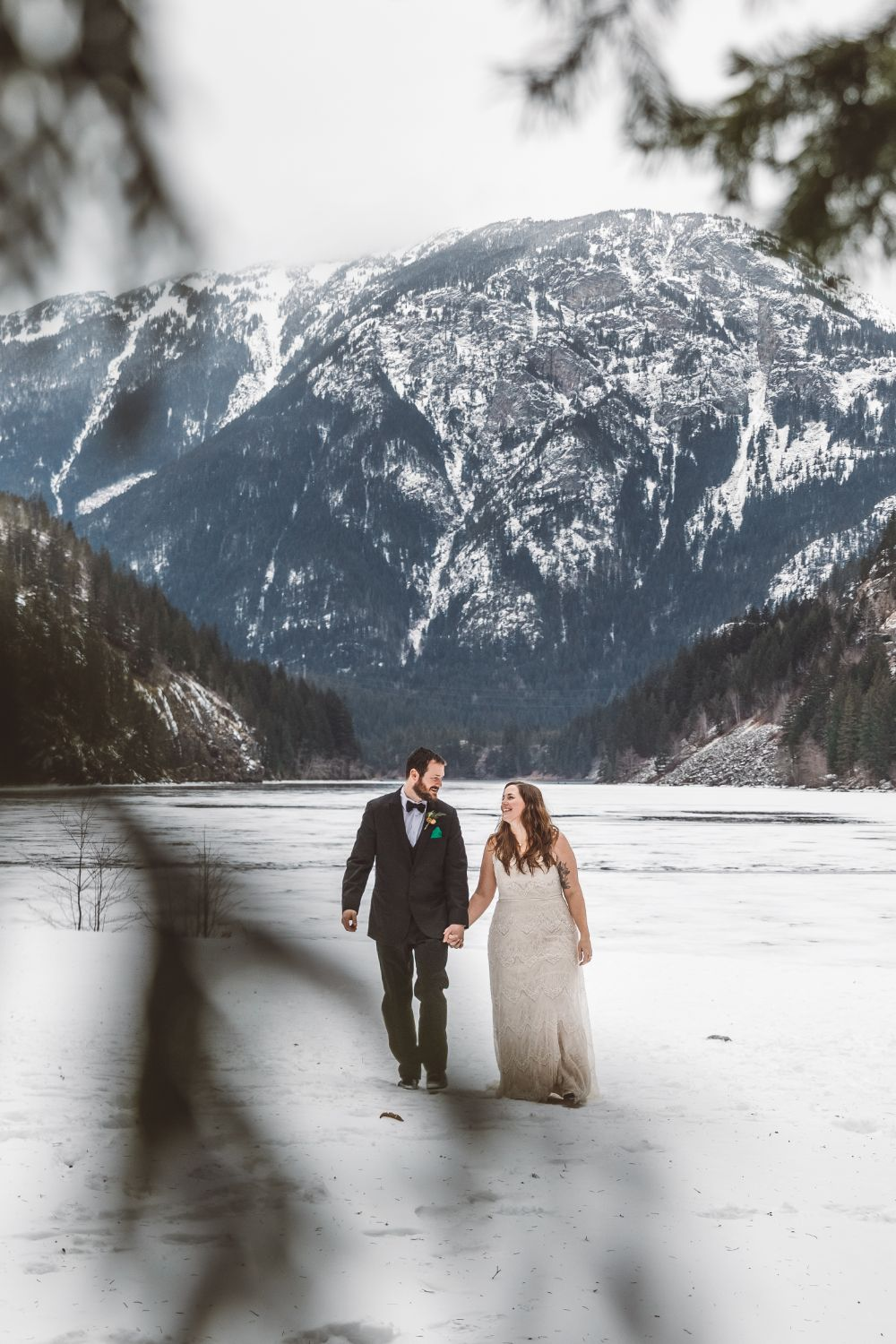 married-couple-hold-hands-north-cascades-adventure-elopement