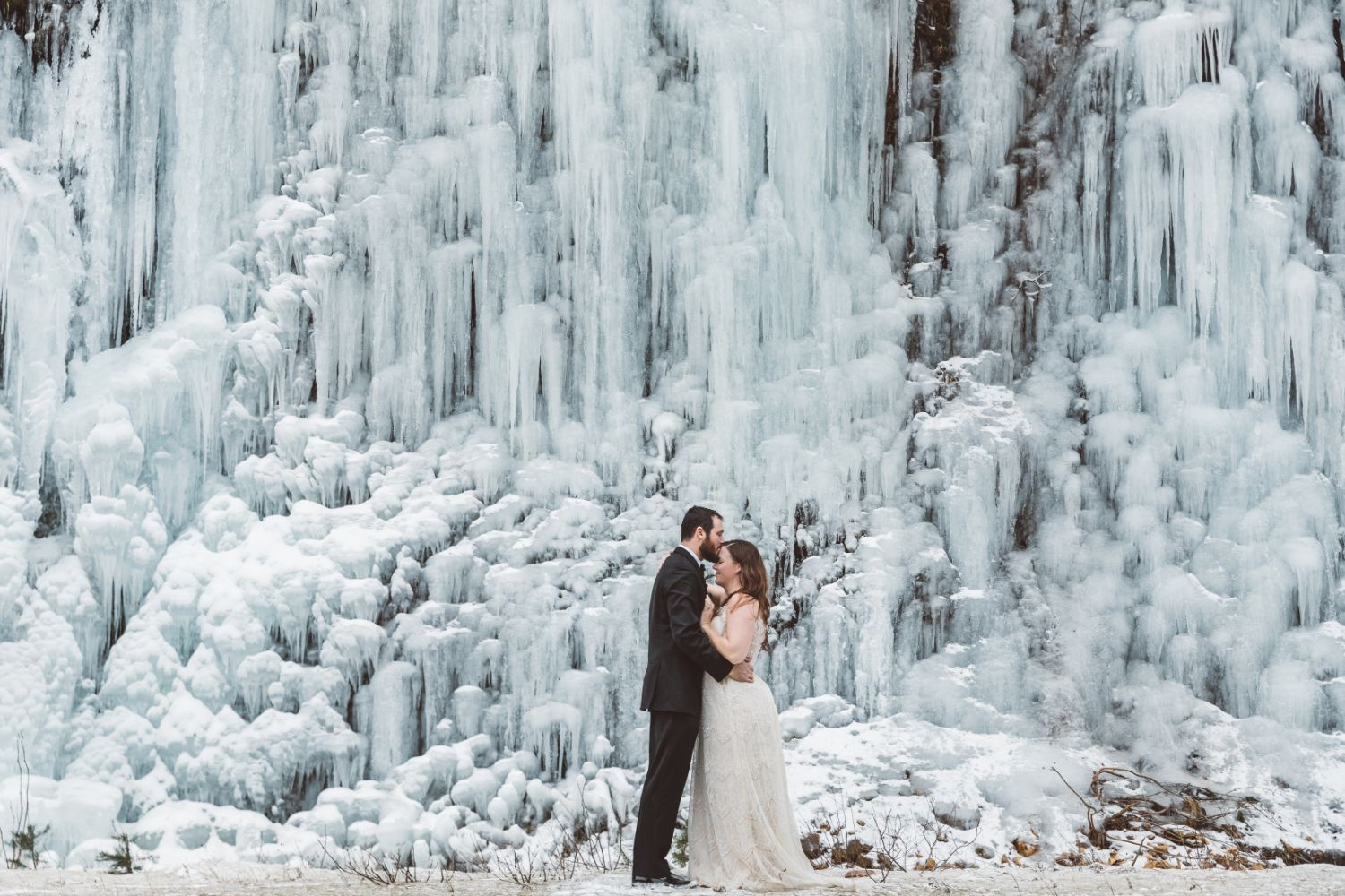 bride-groom-kiss-ice-waterfall-north-cascades