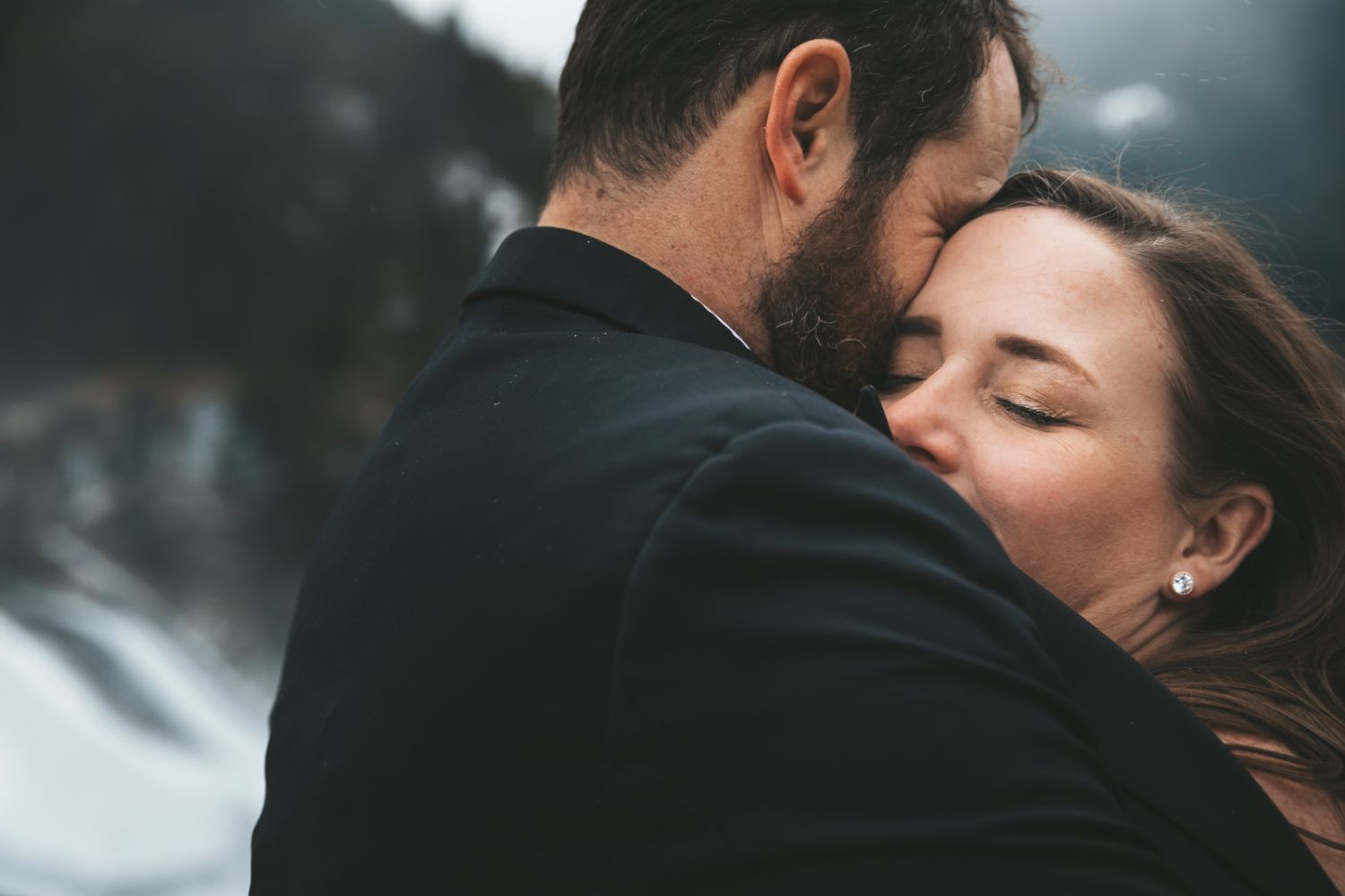 bride-warms-up-groom-embrace-winter-elopement-north-cascades