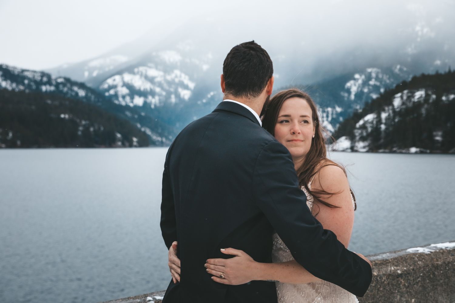 bride-groom-take-in-snowy-mountain-view