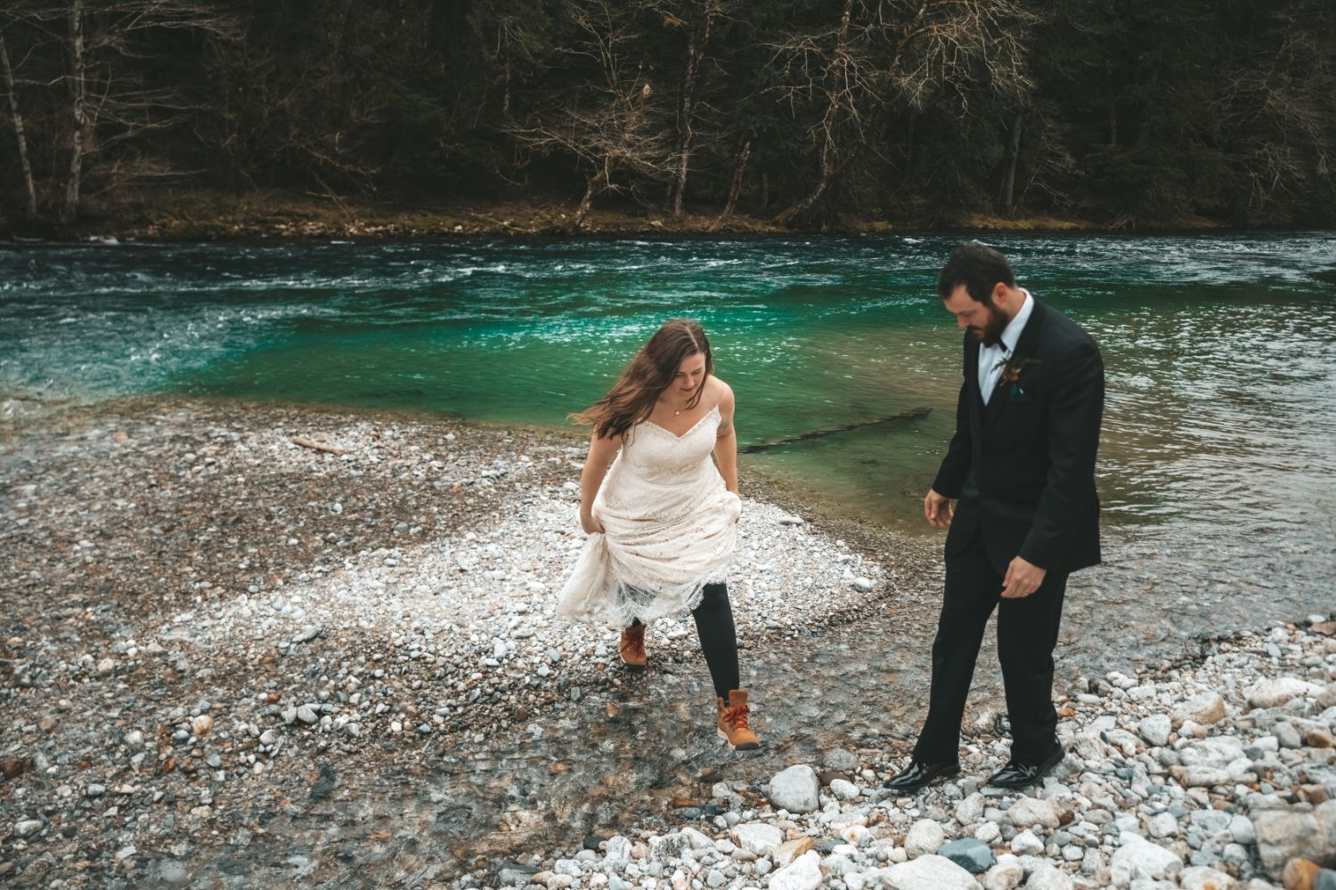 bride-jumps-across-river-hiking-boots-winter-elopement