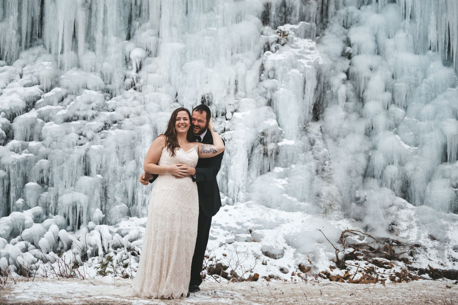 bride-groom-hug-ice-waterfall-north-cascades