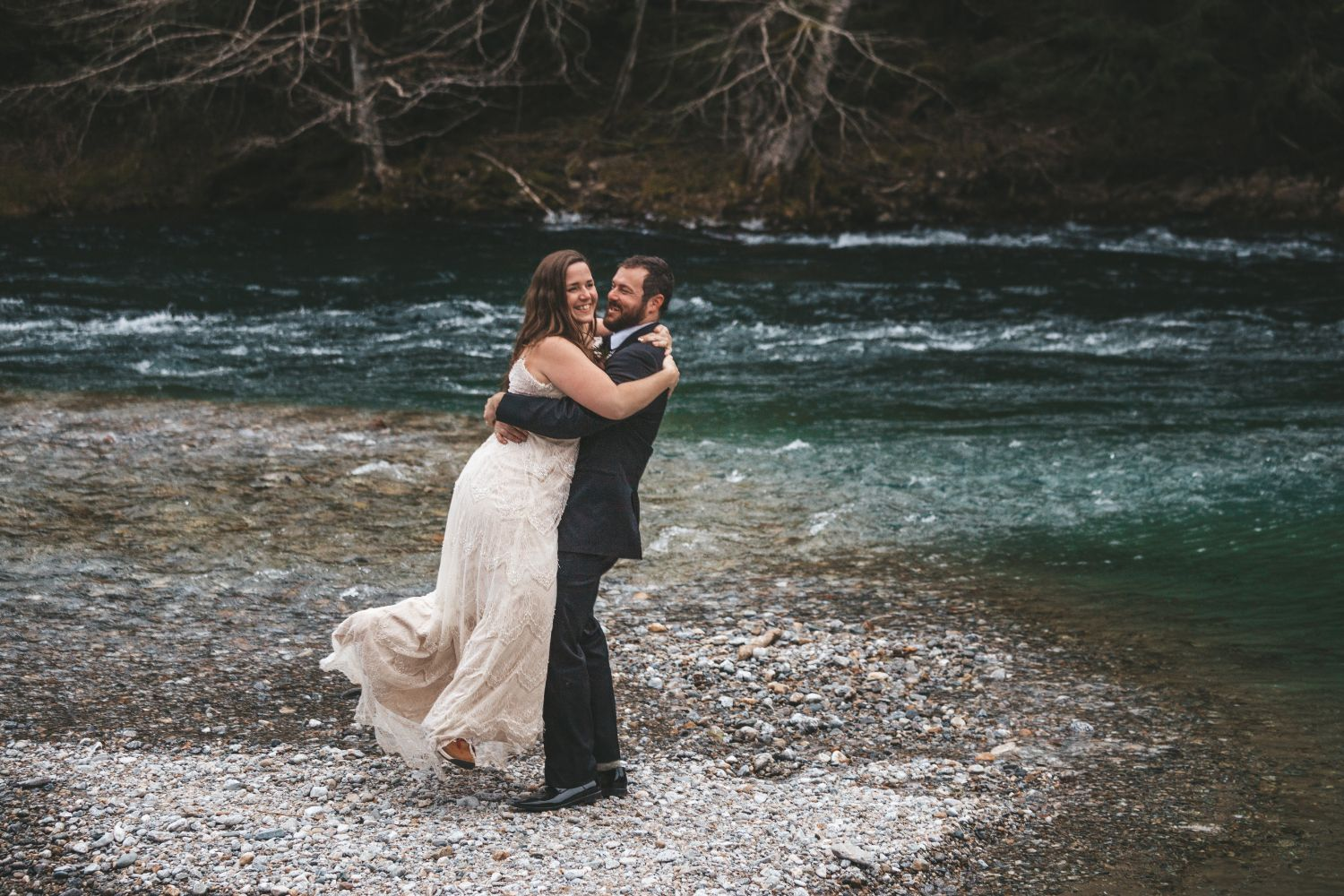 groom-lifts-bride-beautiful-river-north-cascade-winter-wedding