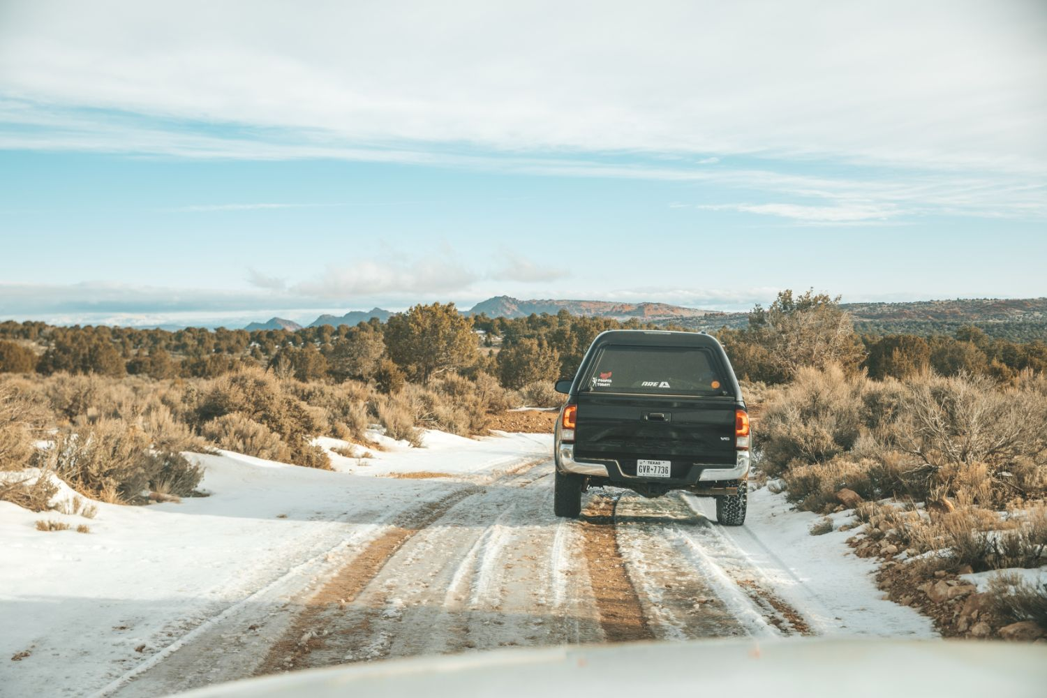 truck-drives-backroad-snow