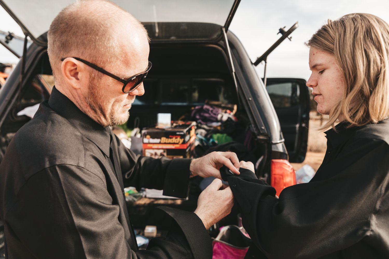 groom-helps-son-get-ready