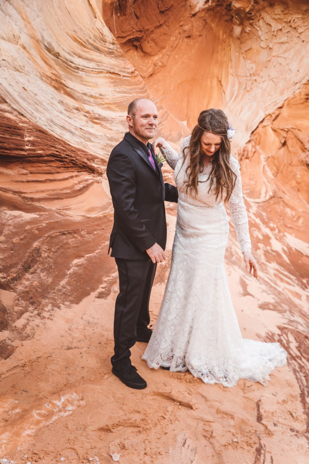 groom-bride-walk-desert-sandstone