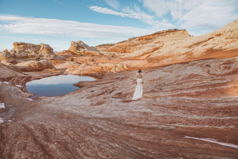 bride-walks-over-landscape-utah-backcountry-elopement-