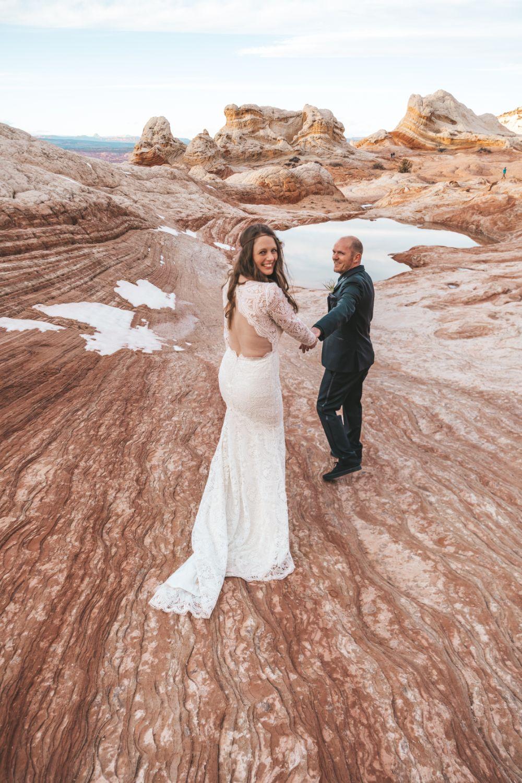couple-hold-hands-utah-desert-adventure-wedding