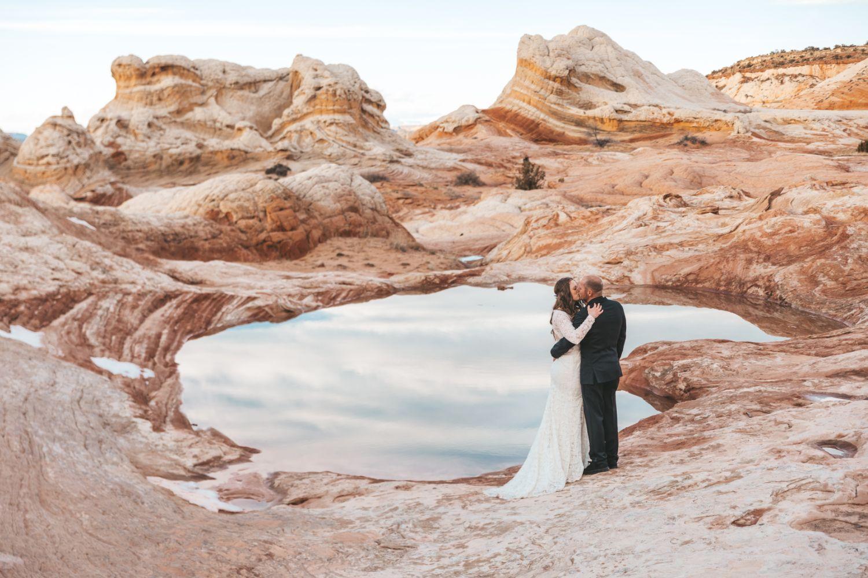couple-embrace-utah-desert-adventure-wedding