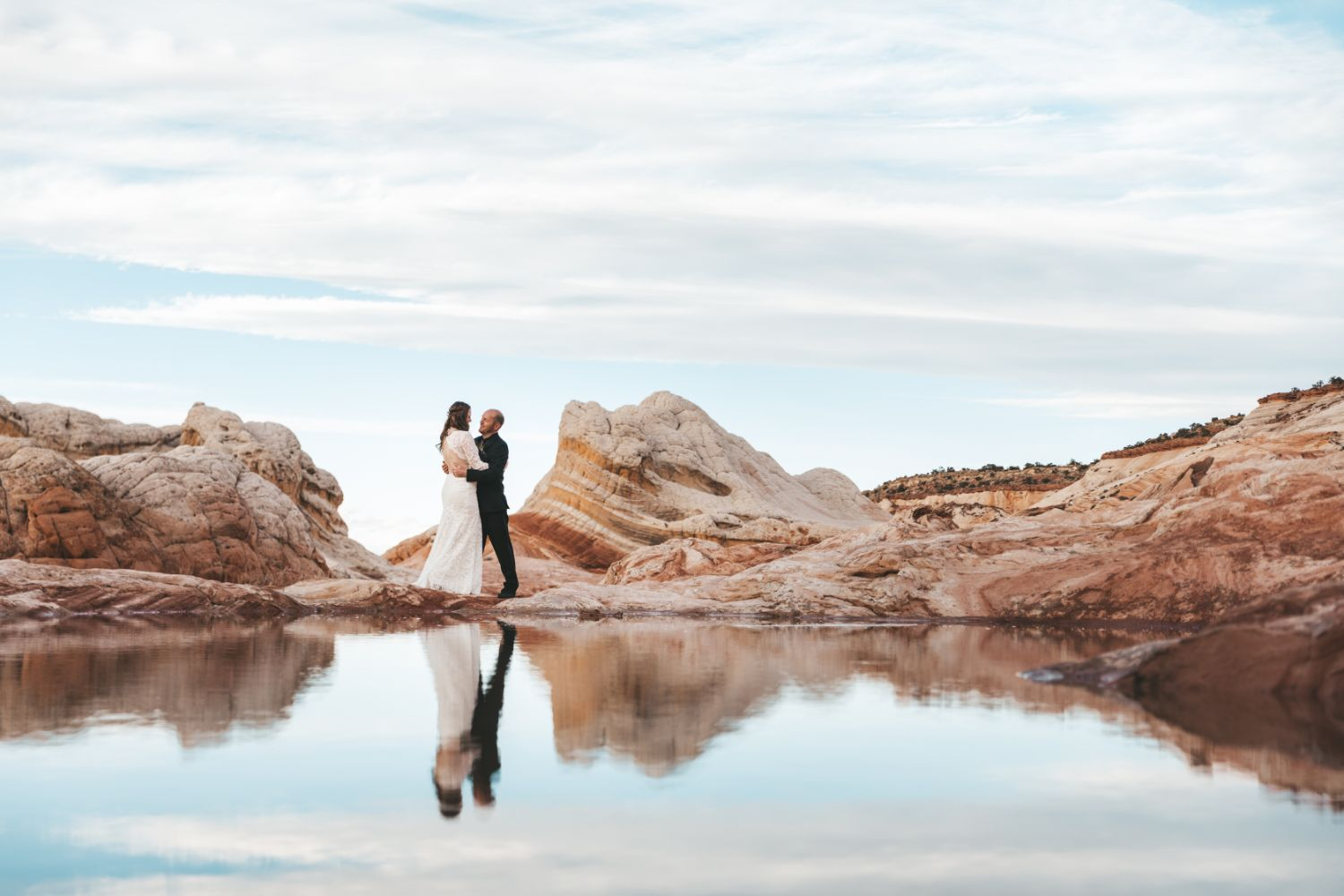 couple-embrace-utah-desert-adventure-wedding