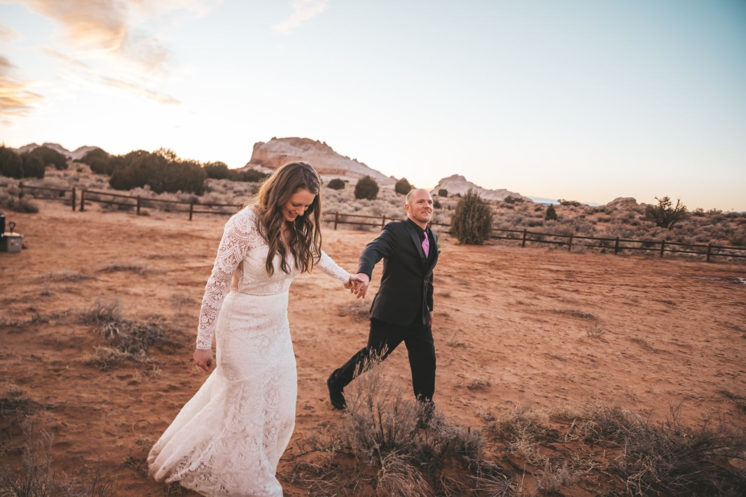 bride-groom-hold-hands-sunset-utah-desert