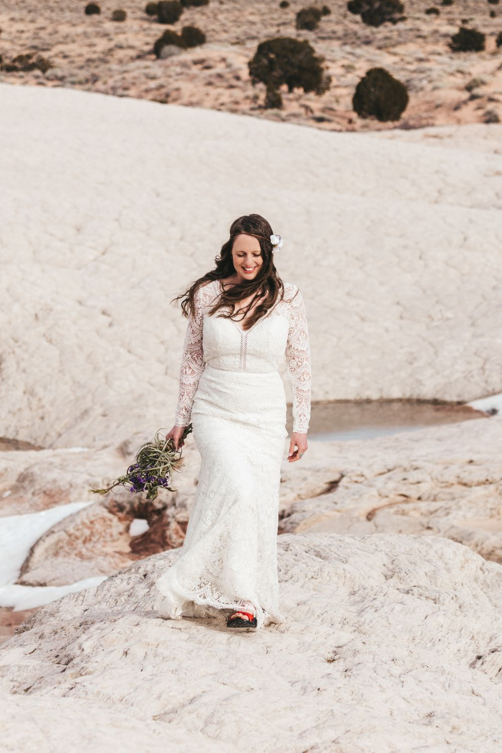 bride-walks-through-utah-desert