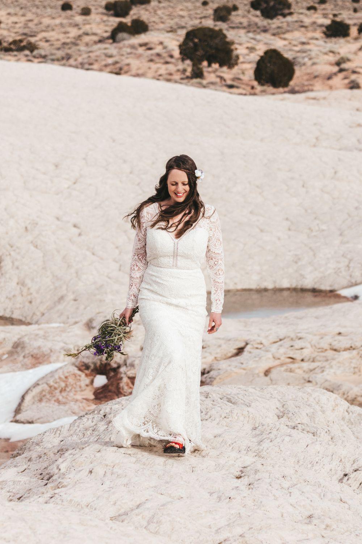 bride-walks-through-utah-desert