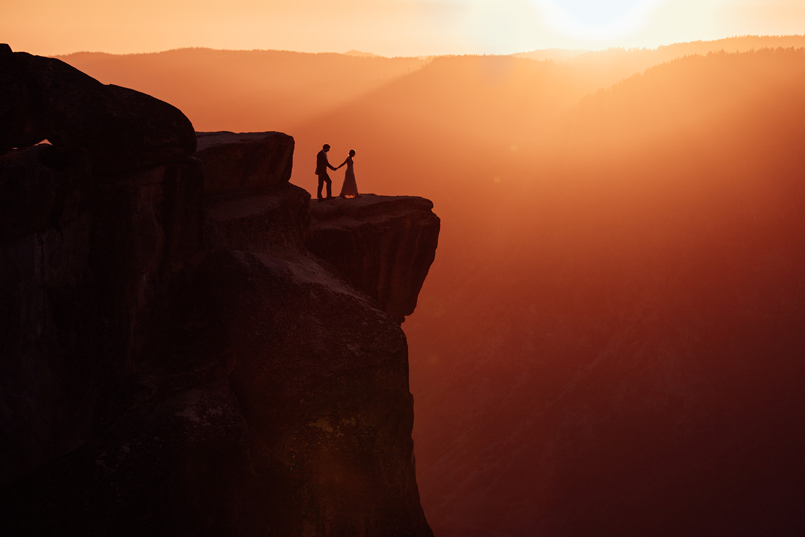couple-walk-to-cliff-edge-elopement