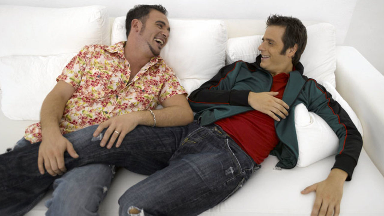 Two-dudes-get-comfy-on-the-couch-Shutterstock-1280x720.jpg