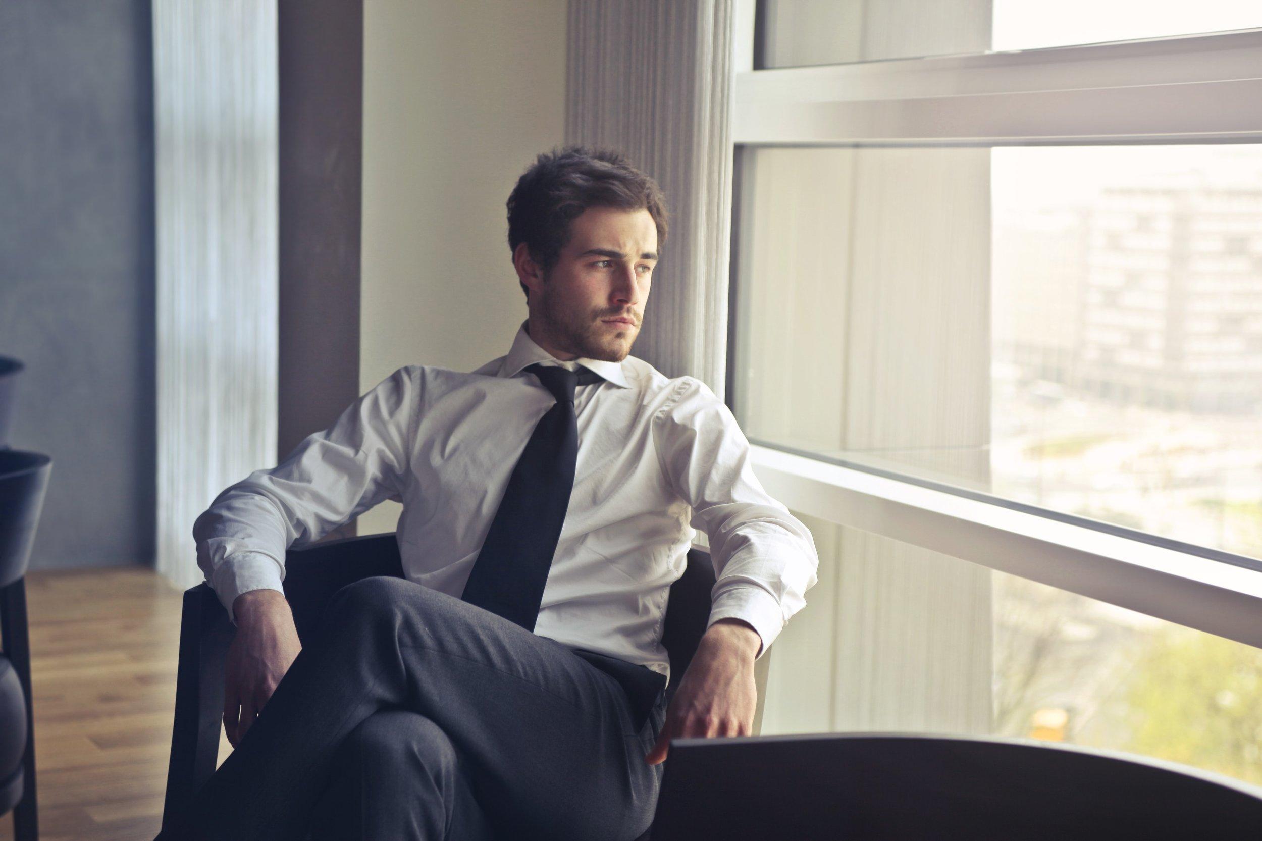 businessman-chairs-facial-expression-716411.jpg