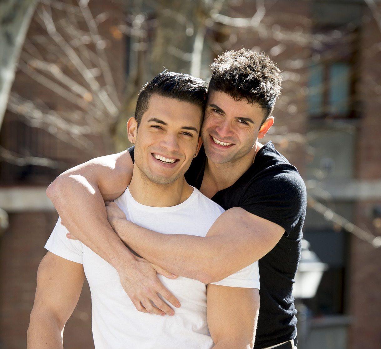 photodune-10417153-young-happy-gay-men-couple-cuddling-on-street-free-homosexual-love-concept-m.jpg