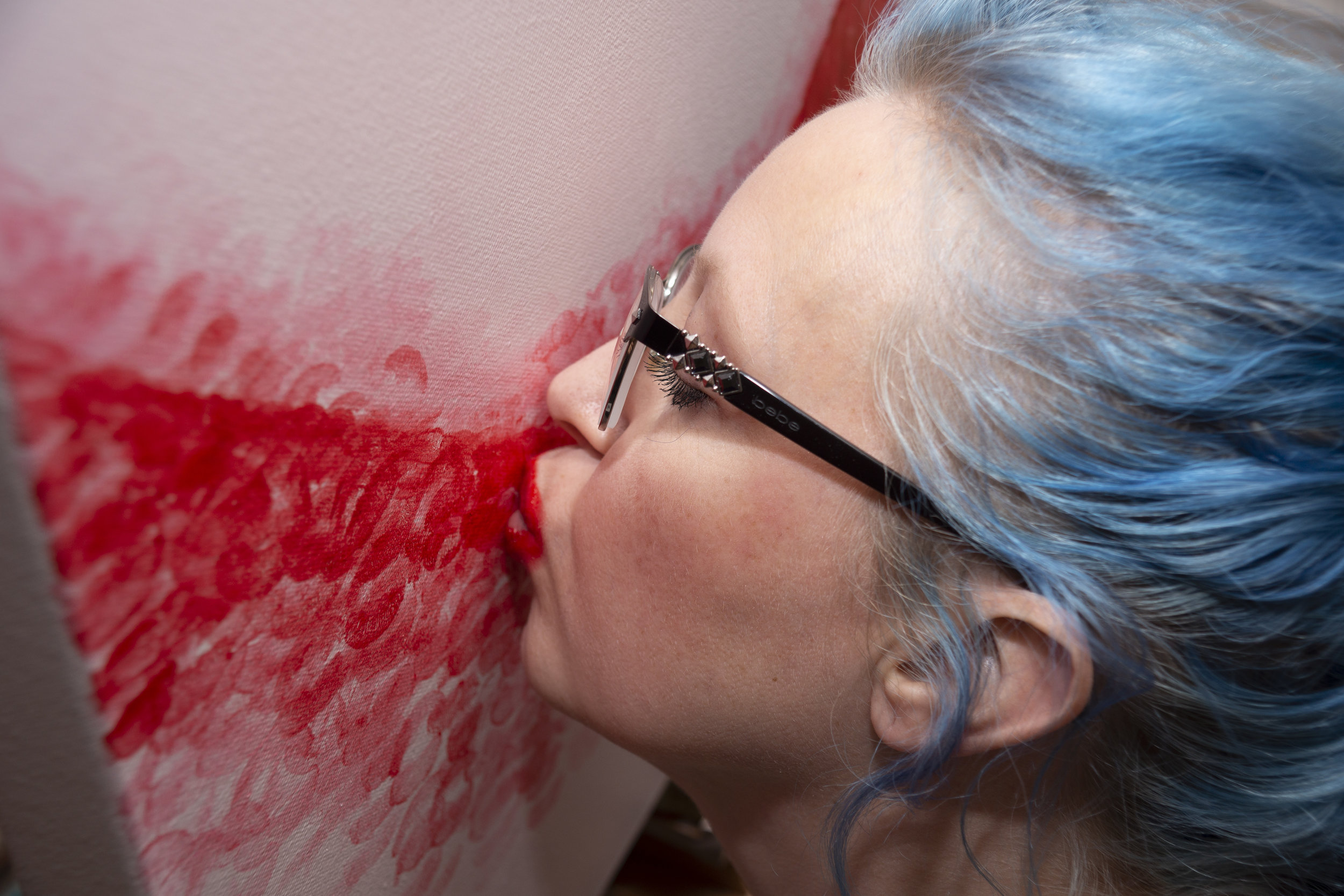 The process - Artwork is created by applying lipstick and kissing the canvas. If a painting is described as lipstick on canvas then it was completed entirely with lip prints, meaning only the artists lips touched the canvas, no brushes were used. Some pieces have backgrounds that have been painted using a brush and acrylics paint, these are indicated as such in the image descriptions.