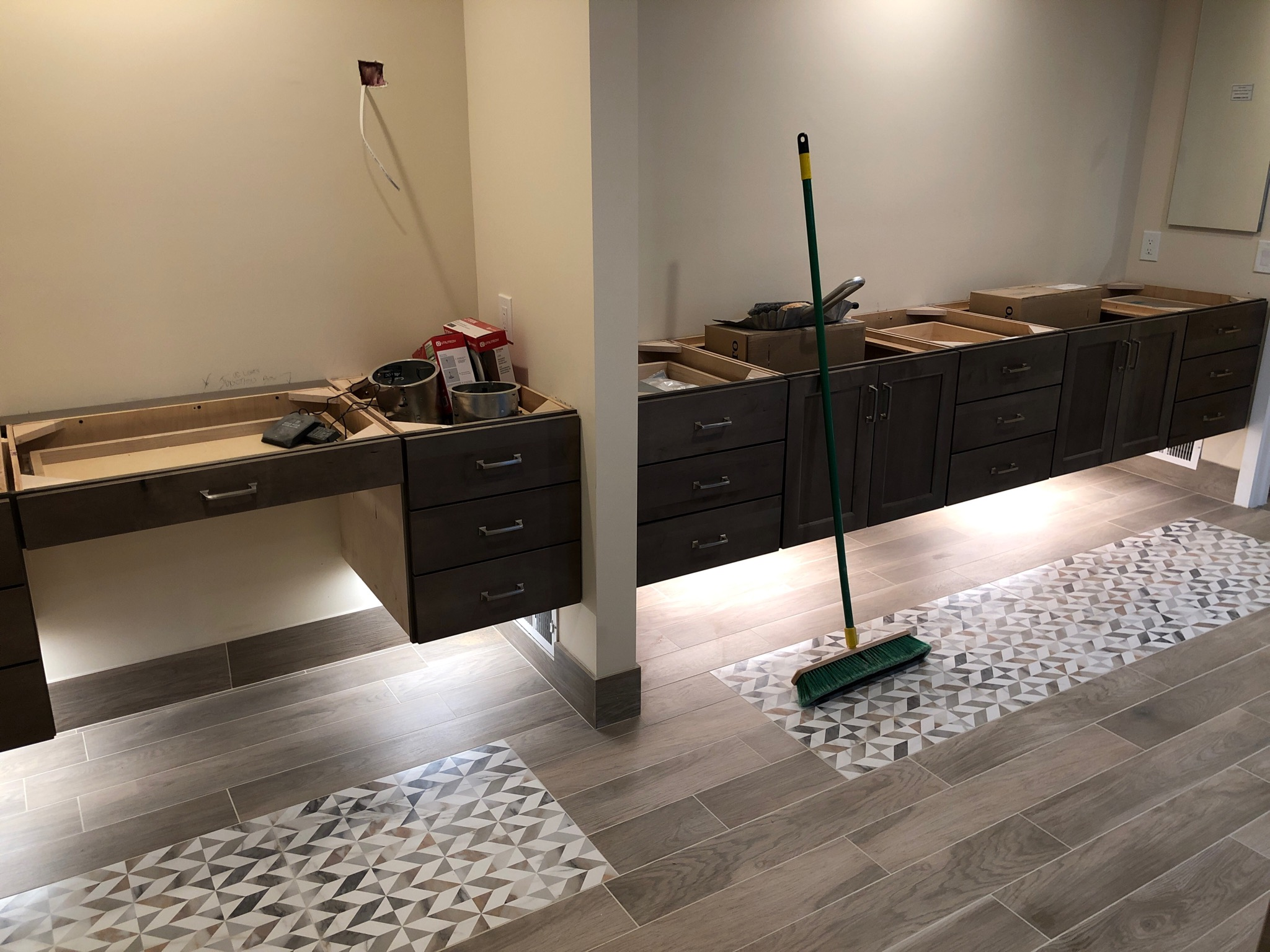 His and Her custom  Pioneer  cabinetry with under-cabinet ambient lighting. These beauties are awaiting their  Cambria  quartz counter-tops.