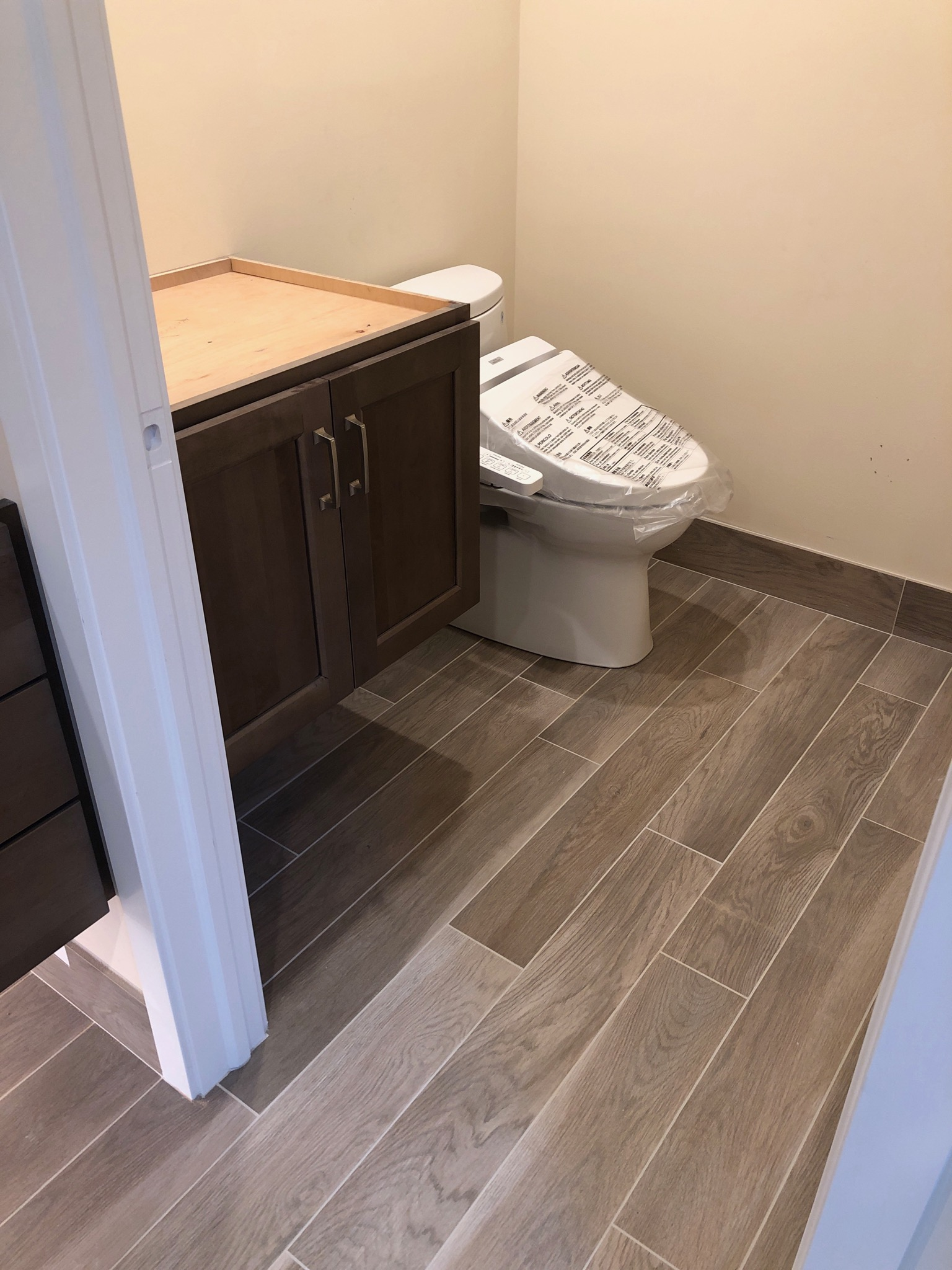 Toilet room newly grouted and waiting for  Cambria  quartz installation.