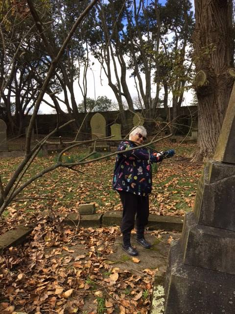 Pruning roses Tricia_Symonds Street Cemetery.jpg