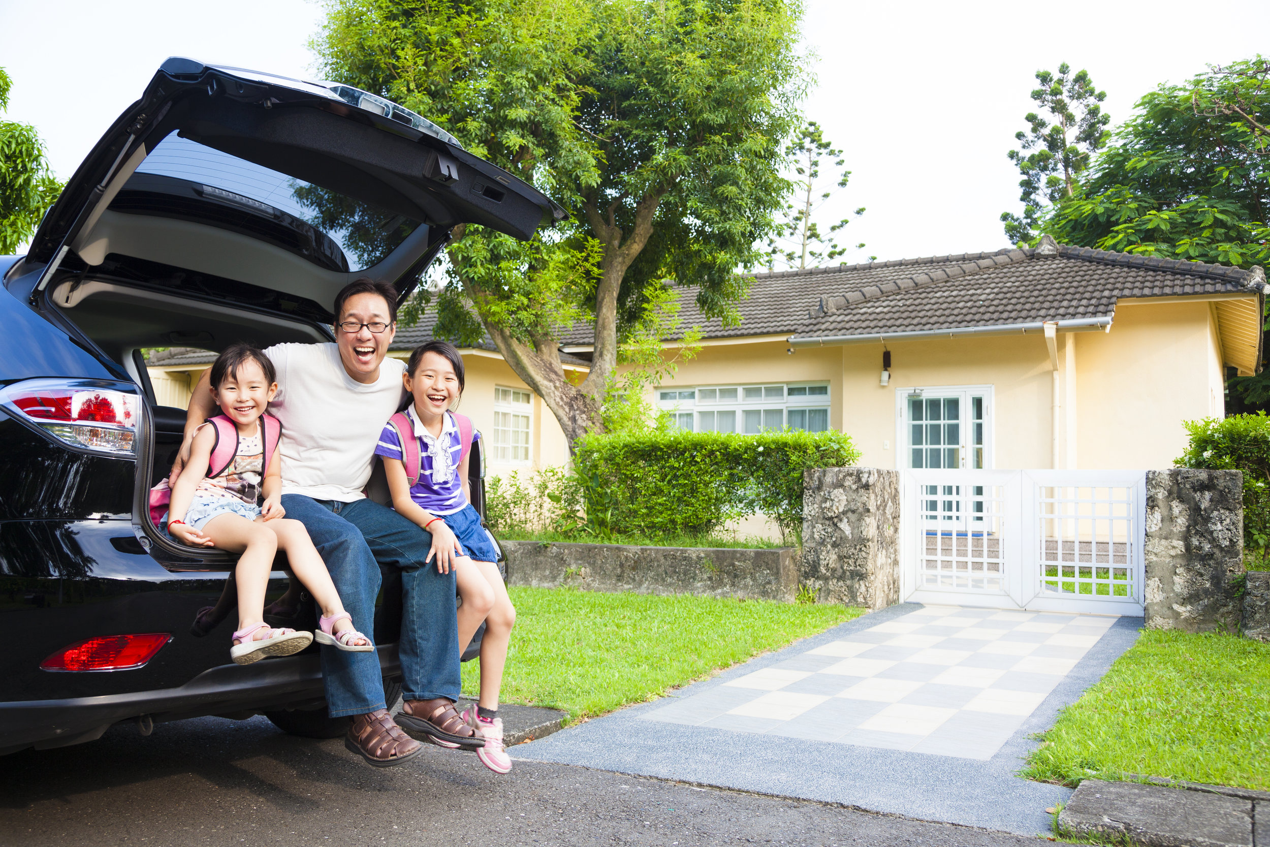 Asian family in front of American house.jpg