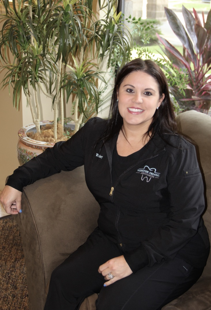 Whitney - Whitney rejoined our practice in 2019 after leaving in 2009 with her husband's move back to central Texas. She shares with our patients her 17 years of experience in dental assisting and front desk experience. Her goal is to make sure our patients feel right at home and comfortable during their visit.She and her husband, Barrett, have been married since 2007 and have two children, Aubrie and Cal Ryan. In her spare time, she enjoys working out, watching her children in their sport activities, being around family, and being outdoors. She is an avid Houston Astros, Texans, and Dynamos fan, and she loves catching games when she can.