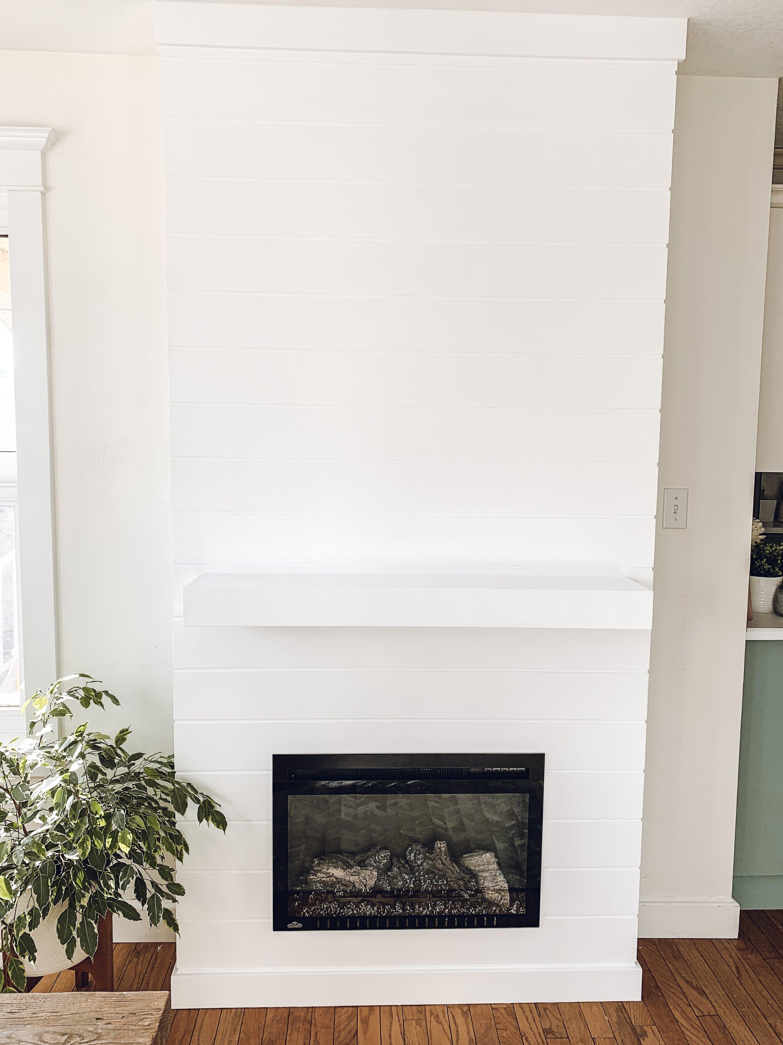 a shiplap electric fireplace