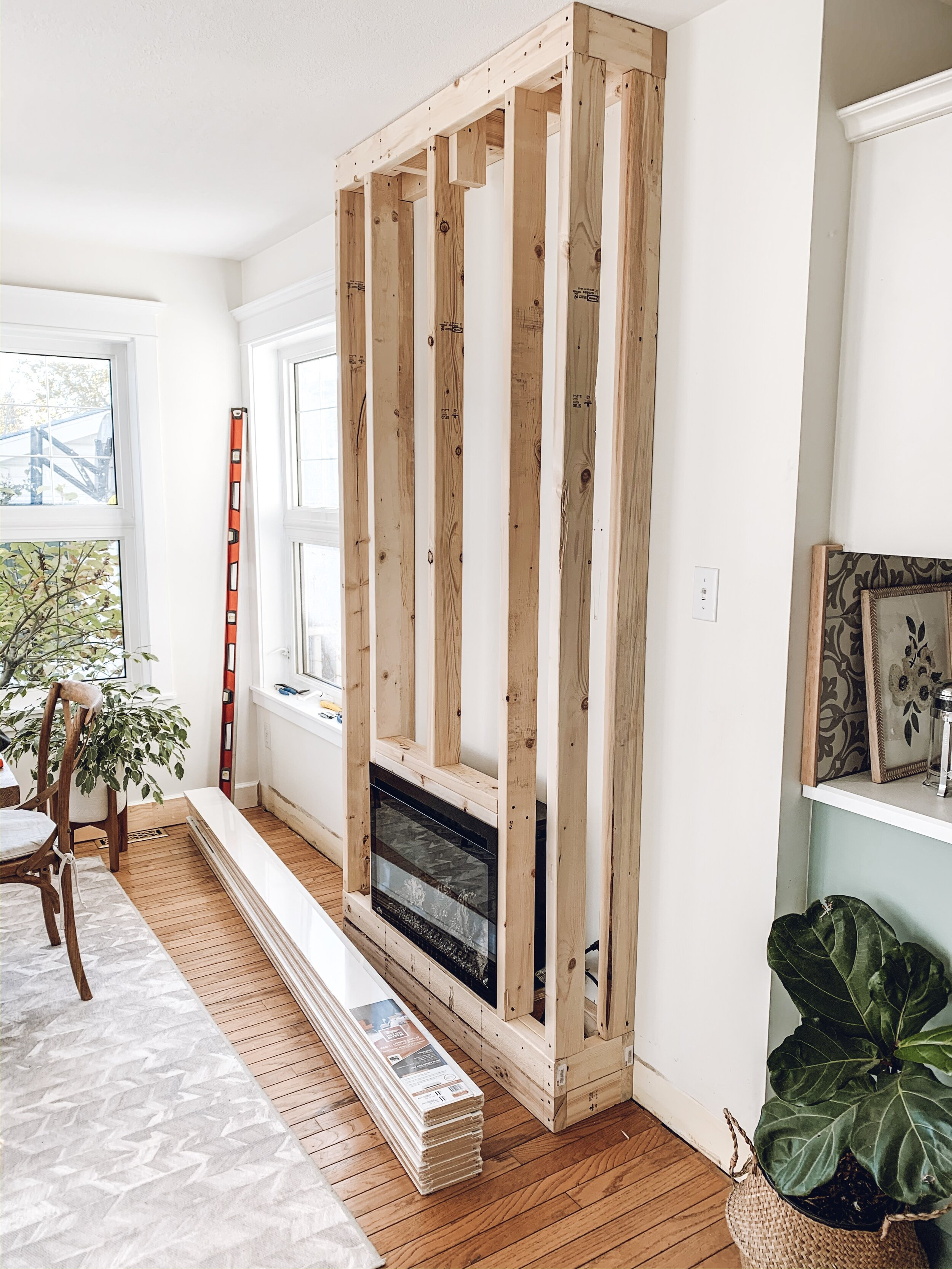 a framed out electric fireplace in a dining room