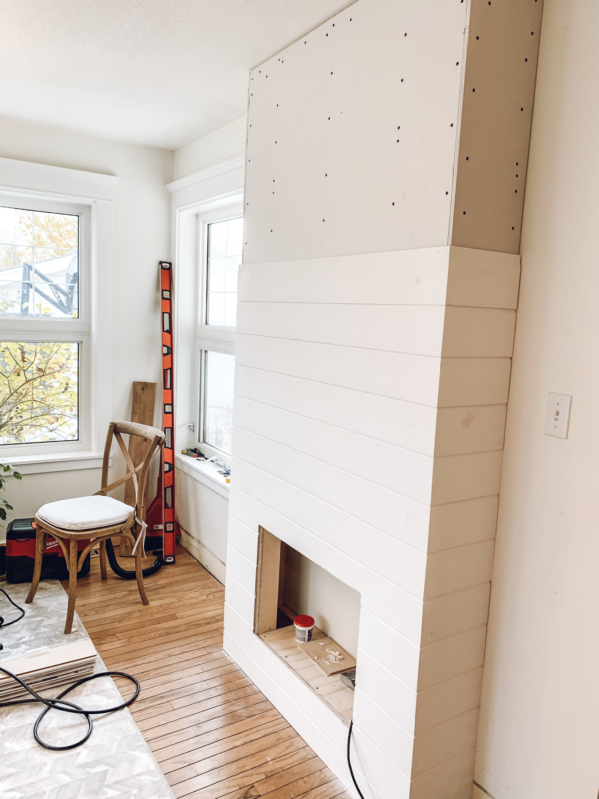 adding shiplap to an electric fireplace