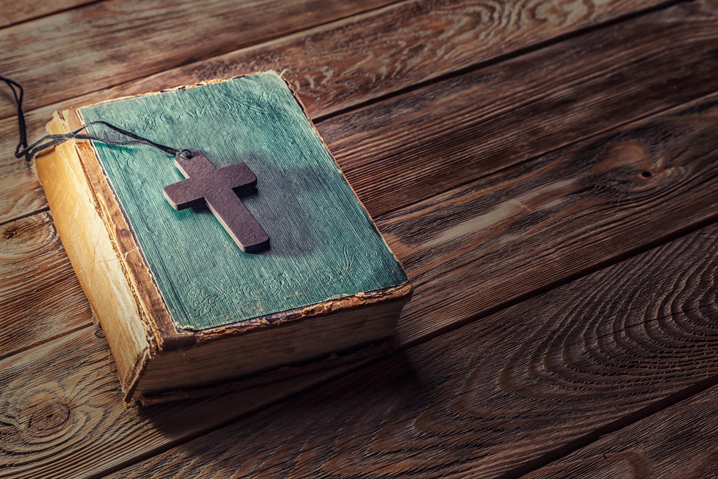 bigstock-Christian-cross-on-bible-105120932.jpg