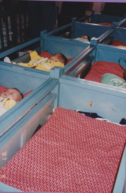 My Blue Crib in Orphanage, 1995   Image Credit: Conover, Leslie. Untitled. 1995, film photograph, Changzhou, China.