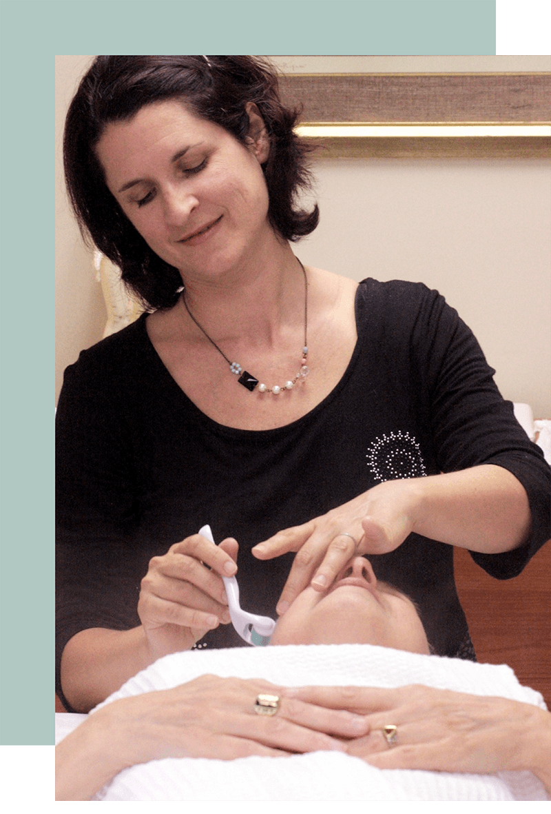 Denver acupuncturist Diana Horowitz giving facial rejuvenation treatment to woman with acu-microneedling Opal Acupuncture
