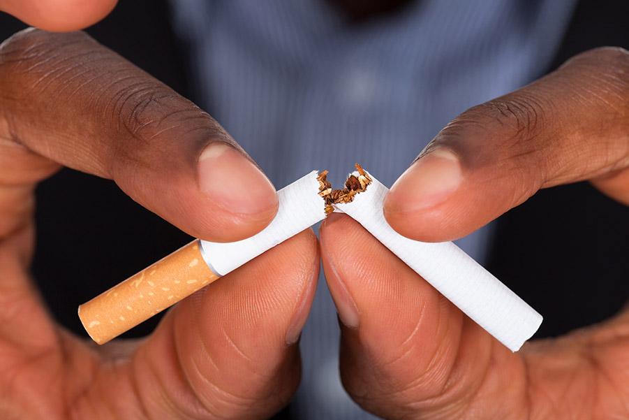 hands breaking cigarette after smoking cessation treatment
