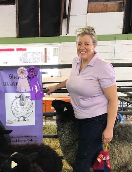Dana L. Salazar - Dana has had many hats; from owning her own framing and art gallery to running her own law firm to shepherding her own flock of sheep; it seems like she's done it all.  The spark for Dana to get sheep was when she went to the Dutchess County Sheep & Wool Festival for the first time and met some very friendly Gotland sheep.  After years of saving and dreaming, Dana was finally able to start her flock with 5 of Quinto Melo Gotland's sheep.  Dana loves shepherding her flock and enjoys the time that it brings her and her daughter together.  Both are eagerly awaiting the arrival of their first batch of yarn.