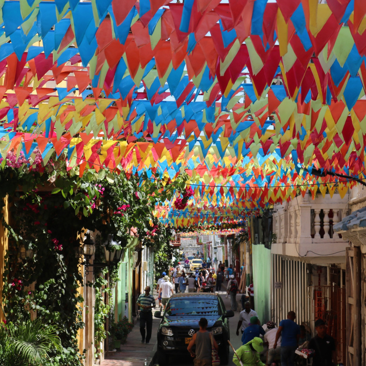 Colorful flags line a street in the walled city