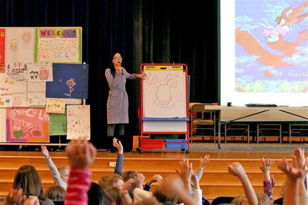 Grace speaking to students on the importance of diverse books.