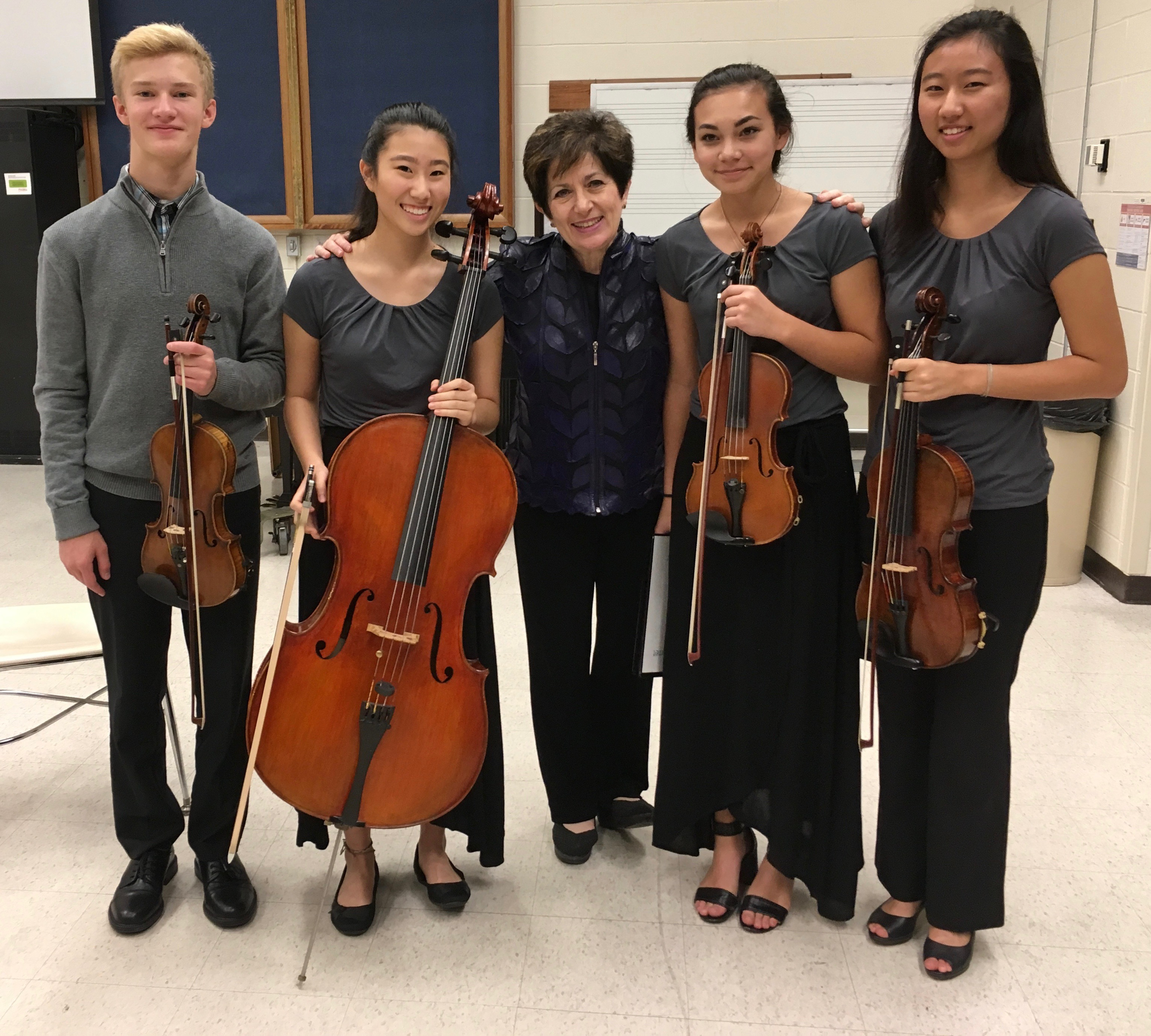 Ida Kavafian, world-renowned violinist and professor at the Juilliard School and the Curtis Institute, with the Klier String Quartet made up of student from Ames and Gilbert High School.