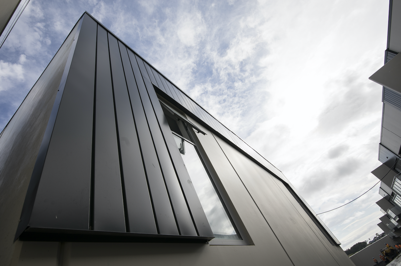 The Roofing Store - K-Road Live and Work - Vitor+ Interlocking Steel Cladding Windsor Grey.png