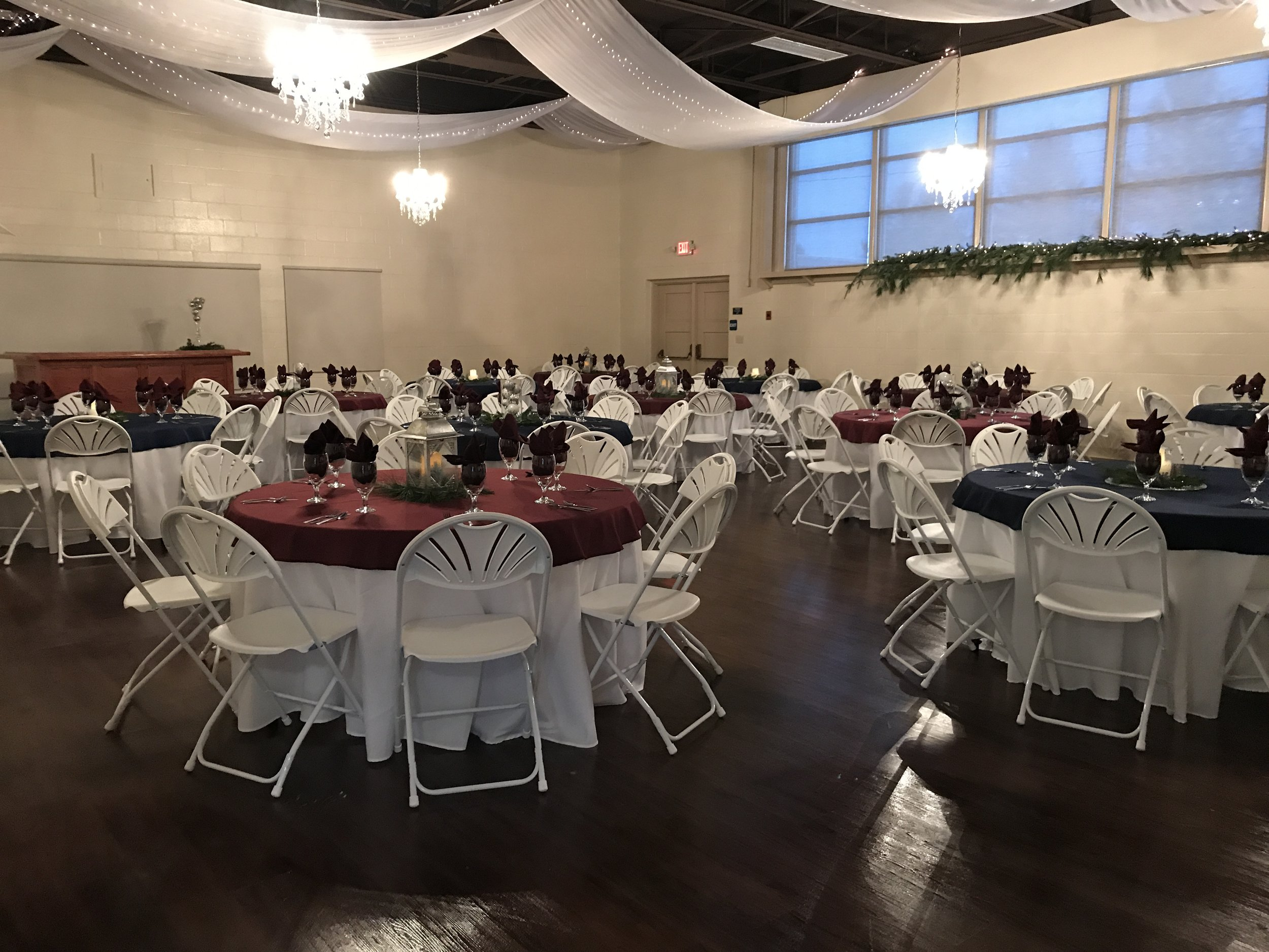 The Auditorium - Our indoor Auditorium room holds 100 guests. It's beautiful chandeliers and refinished stage create the perfect atmosphere to host your intimate affair.  From baby shower to Holiday parties, this climate controlled room is the perfect place to host your event!