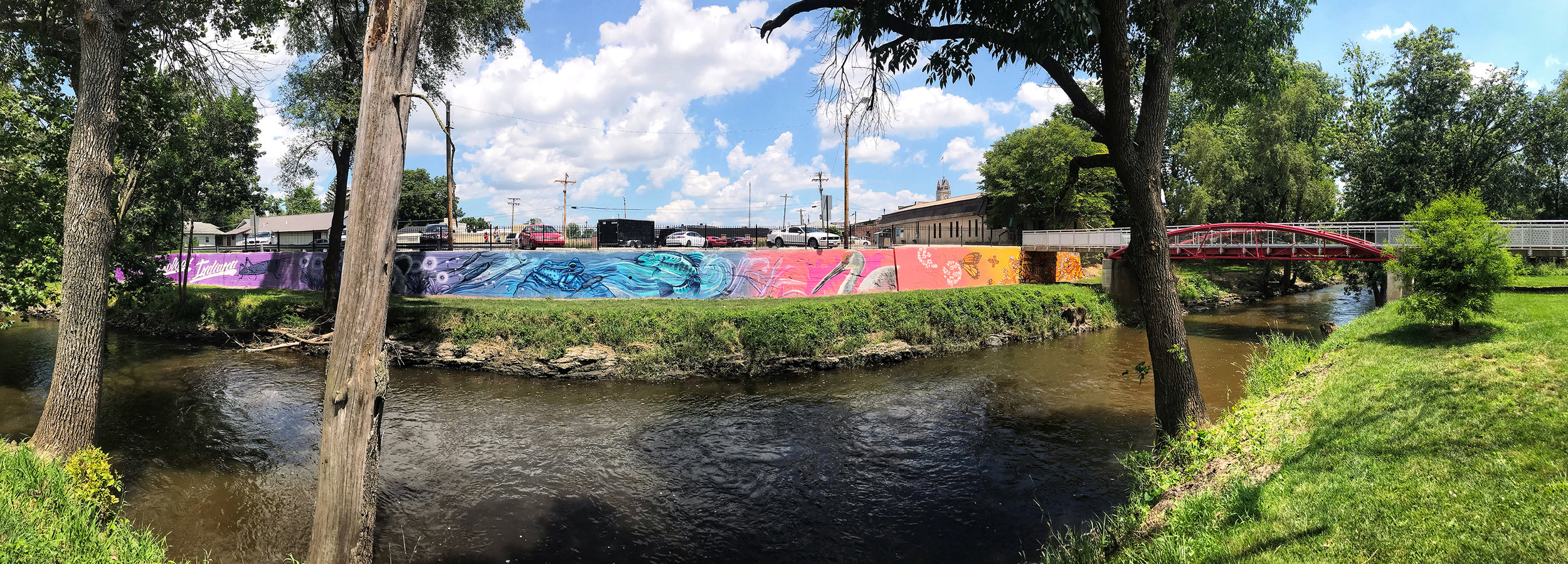 MURAL 1 - Potawatomi Park Collaboration: This mural is a collaborated effort by Jenna Morello, Andre Cobre, Chris Chanyang Shim, Cameron Moberg, and Emily Ding. Best viewed in Potawatomi Park across the Iroquois River.