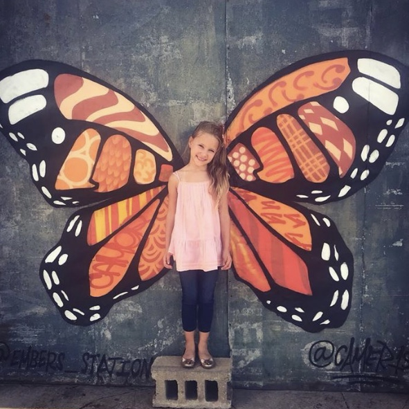 MURAL 17 - Currently off the current mural path, these interactive butterfly wings from Cameron Moberg have been a downtown favorite photo op for over a year.