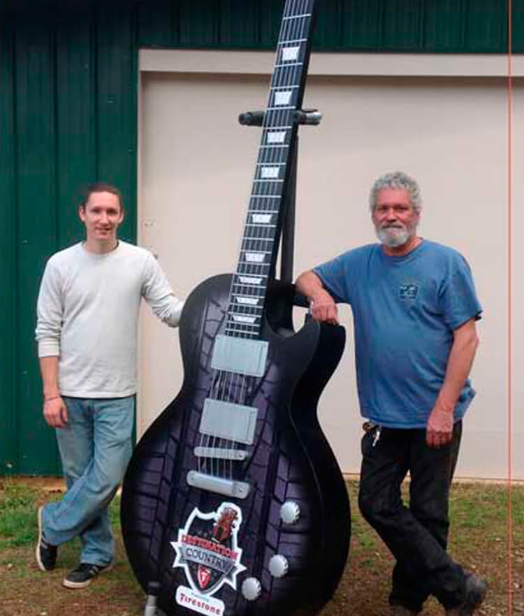 Atlanta Props™ Custom Oversized Props - Giant Guitar for Firestone Tire Events