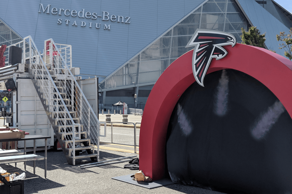 Atlanta Props™ Custom Event and Display Props - Atlanta Falcons Photo Op Stage at Mercedes Benz Stadium