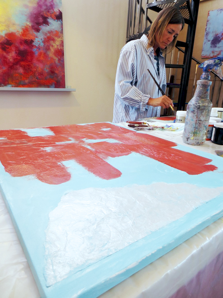 A student using aluminum foil in a painting