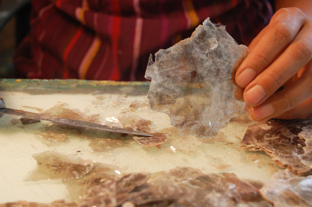 Slicing thin sheets of New Mexican mica in preparation for use in a painting
