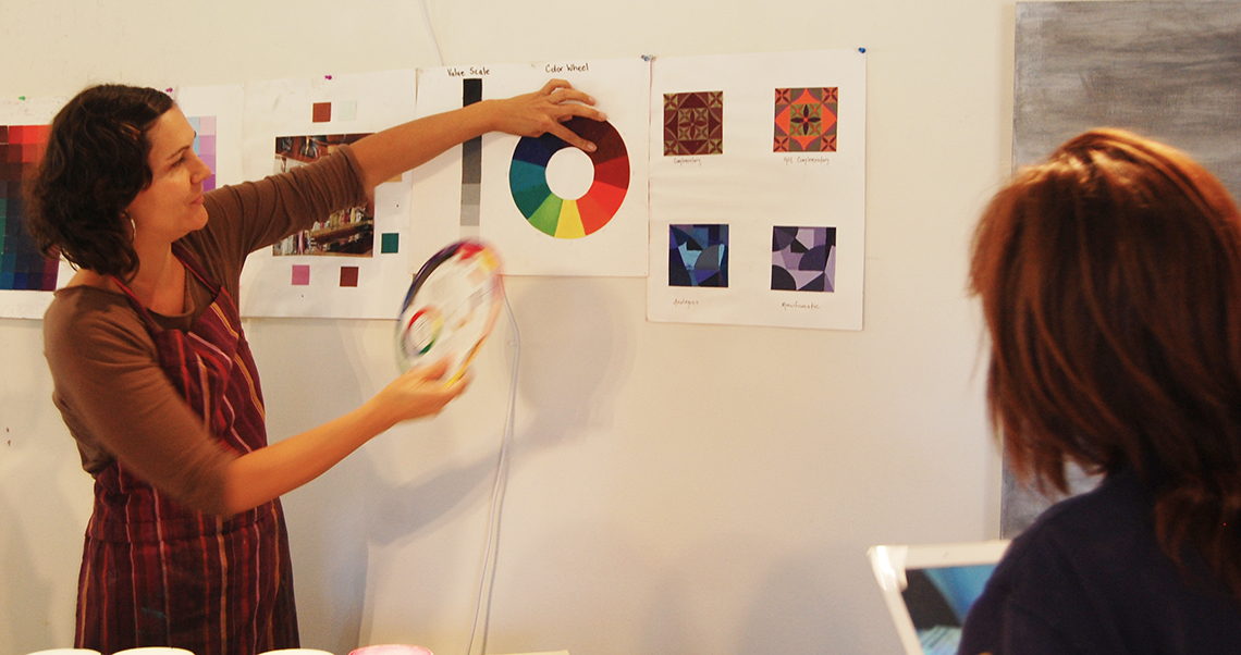 Instructor  Andrea Cermanski  teaching about the color wheel.